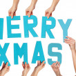 Stock Photo: Turquoise MERRY XMAS greeting with sexy Santa