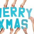Turquoise MERRY XMAS greeting with sexy Santa — Stock Photo #14307001