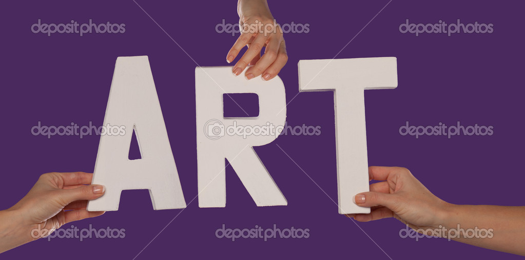 White alphabet lettering spelling ART held up over a purple studio background by outstreched female hands — Stock Photo #14302425