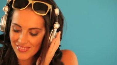 Brunette disc jockey listening to music — Stock Video
