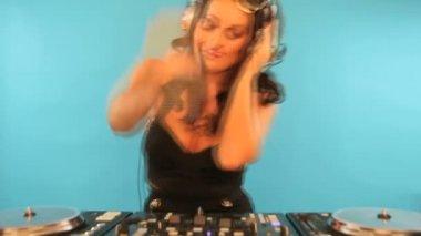 Beautiful brunette disc jockey — Stock Video