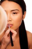 Beautfiul Asian woman applying lipstick — Stock Photo