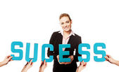 Businesswoman with the word Success — Stock Photo