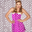 Retro fashion model in polka dot dress — Stock Photo #16795809