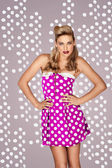 Retro fashion model in polka dot dress — Stock Photo
