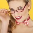 Beautiful blonde in a glasses and a bowtie — Stock Photo #16938269