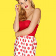 Retro fashion model in red polka dots — Stock Photo #16953909