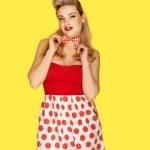 Retro fashion model in red polka dots — Stock Photo