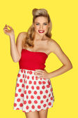 Retro fashion model in red polka dots — Stock Photo