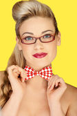 Beautiful blonde in a glasses and a bowtie — Stock Photo