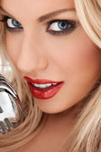 Glamorous blonde vocalist or diva — Stock Photo
