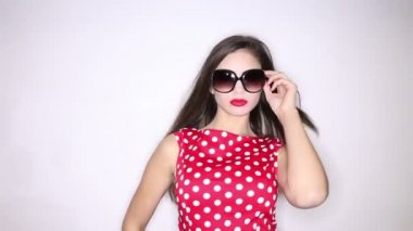 Polka dots dress girl — Stock Video #21362547
