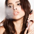 Woman smoking e-cigarette — Stock Photo