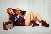 Hot brunette model with radio — Stock Photo