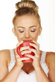Blonde drinking from mug — Stock Photo