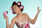 Woman in haircurlers with hairdryer — Stock Photo