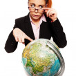 Businesswoman looking dumb pointing to a globe — Stock fotografie