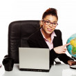 Businesswoman with a world globe — Stock Photo