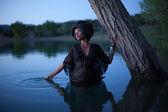 Beautiful woman wading in water — Stock Photo