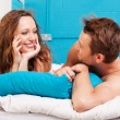 Stockfoto: Young couple having fun in a bed