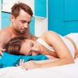 Stock Photo: Young couple having fun in a bed