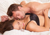 Young man and woman in bed. Couple. — Stock Photo