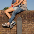 Stock Photo: Skateboarder couple