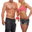 Muscular sexy couple working out — Stock Photo
