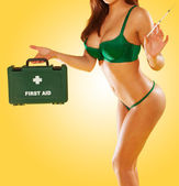 Sexy woman carrying a first aid kit — Stock Photo