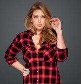 Gorgeous blond in a red checked shirt — Stock Photo