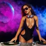 Glamorous sexy busty DJ — Stock Photo