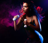 Sexy woman working out with dumbell — Stok fotoğraf