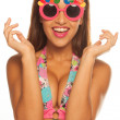 Girl celebrating wearing birthday sunglasses on white — Stock Photo