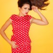 Stock Photo: Hot woman wearing red polka dots dress with black stiletto