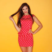 Hot woman wearing red polka dots dress with black stiletto — Stock Photo