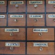 Cabinet of drawers with vintage labels — 图库照片