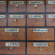 Cabinet of drawers with vintage labels — Stok fotoğraf