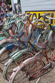 Row of bicycles in a cycle rack — Stock Photo