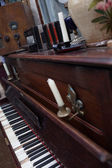 Open vintage piano with candles — Stock Photo