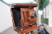 Vintage wooden bellows camera — Stock Photo