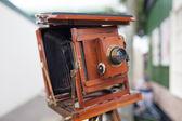 Vintage wooden bellows camera — Stock Photo