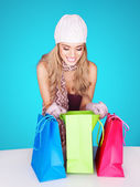 Beautiful female shopper checking her purchases — Stock Photo