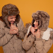 Happy couple in warm winter clothing — Stock Photo