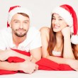Happy young couple on a Christmas mood — Stock Photo