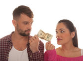 Young couple holding a twenty US dollar bank note — Stock Photo