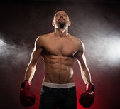 Low angle view of a fit caucasian boxer — Stock Photo