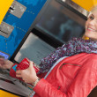 Stock Photo: Beautiful smiling womusing bank ATM