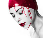 Dramatic portrait of a bleeding woman — Stock Photo