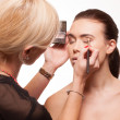 Beautician applying eye makeup — Stock Photo