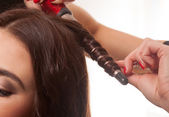 Woman having her hair curled — Stockfoto